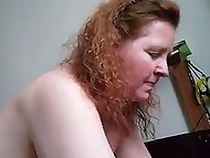 Man feels satisfied with fucking red-haired mature as well as with recording this action on camera 9