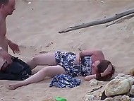 Indecisive man takes off pants and shoves cock in lazy girlfriend's pussy on sandy beach 11