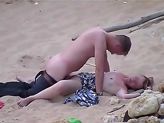 Indecisive man takes off pants and shoves cock in lazy girlfriend's pussy on sandy beach
