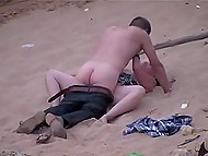 Indecisive man takes off pants and shoves cock in lazy girlfriend's pussy on sandy beach 5