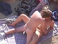 Nudist MILF spreads legs in front of husband on the beach and they getting filmed by voyeur 4