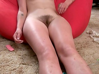 Pretty chick is studying her wet hole and uses comb to make a new coiffure on pussy