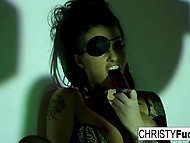 Wonderful brunette Christy Mack with eyepatch shoves adult toy in smooth pussy