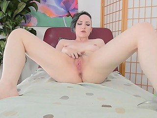 Irresistible brunette with pierced nipples neatly fingers her hairy vagina alone