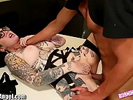 Emo girl with full-tattooed body lays on the table wanting skinny guy to penetrate her pussy 11