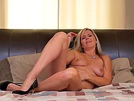 Mature blonde lies in bed and gives amazing massage to her sweet peach 7