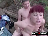 Red-headed slut is satisfying two guys in the woods and enjoys a good threesome fuck
