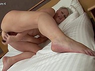 Mature British female with short hairdo puts lustful cunt on metallic dildo under camera's aim