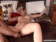 Experienced lesbian with dark skin carefully dildoes short-haired British lover's vagina 6