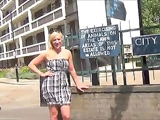 Blonde-haired nympho from Britain walks on the street and flashes pussy lifting summer dress