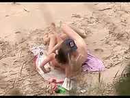 Spy with camera records dude in cap polishing sissy of his skinny beloved on the beach 11