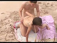 Spy with camera records dude in cap polishing sissy of his skinny beloved on the beach