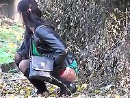 Voyeur takes a strategic position and captures some random females peeing behind the bushes 11