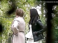 Voyeur takes a strategic position and captures some random females peeing behind the bushes 5