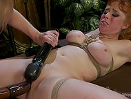 Enticing redhead and her blonde girlfriend are having fun with amazing sex toys 11