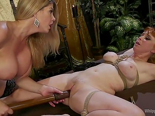 Enticing redhead and her blonde girlfriend are having fun with amazing sex toys