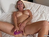 Old blonde woman doubles sexual pleasure stretching asshole with beds riding hard dick