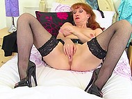 Mature redhead is ready to feel crazy orgasm by shoving black dildo in wet peach