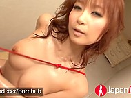 Red-haired Japanese girl rubs rope against her oiled muff in absence of any hard penis 4