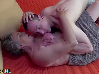 Old woman didn't lose her seducing skills through years and now got young cock in hairy muff