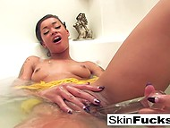 Ebony beauty Skin Diamond relaxes alone in bathroom where she toys her bald pussy