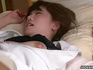 Light-brained Japanese girl spreads legs widely to let cavalier tease her muff with vibrator 4
