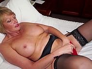 Lonely dame with huge tits is used to satisfy sexual desire on her own with help of big dildo