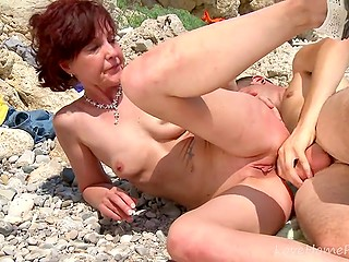 Boy picked up MILF with red hair on beach and played dirty games with her holes on camera