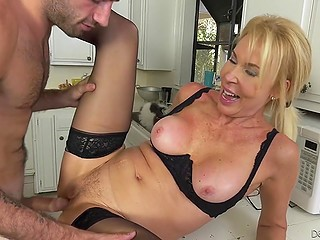 Mature woman had no sex for a long time so she obliged tenant to fuck her on kitchen table