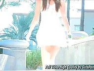 Glamour brunette in short dress feels no shame teasing her pussy in public places 6