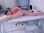 Russian beauty Evelina Darling awaits client in massage parlor killing time with masturbation 8