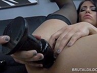 Brunette in black stockings is almost crying in pleasure when huge dildos hammer tight asshole 4