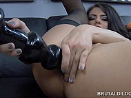 Brunette in black stockings is almost crying in pleasure when huge dildos hammer tight asshole 5
