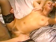 Slender Danish blonde in stockings gets fucked by two chasers in vintage porn video 6