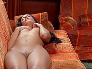Entrancing brunette takes pictures of her ass and gets so excited that masturbates on sofa 9