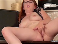 Young woman Jenny Smith with red hair permits nimble fingers to play with shaved pussy 8