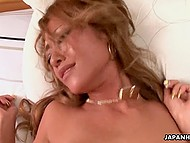Juicy pussy of tanned beauty from Japan quickly wets her boyfriend's small penis 9