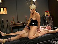 Dominant blonde in latex fucks hanged man with strapon then saddles his cock with pussy 10