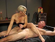 Dominant blonde in latex fucks hanged man with strapon then saddles his cock with pussy 11