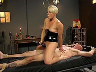 Dominant blonde in latex fucks hanged man with strapon then saddles his cock with pussy 9