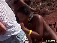 Black colleen with collar sucks penis while white male fucks her from behind in desert 5
