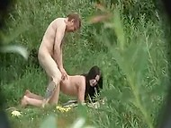Dense grass hides spy with camera well while he records young couple having sex on lawn