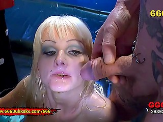 Blonde whore licks crotches and anuses receiving urine streams over her face in parallel