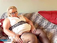 Mature blonde is touching her nipples to arouse herself before pushing hot fingers into pierced pussy 7