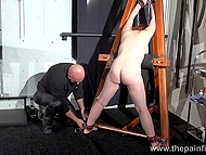 Mature pervert with bald head spanks red-haired Swedish slave to redness on her butt