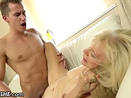 Youngster feels his dick getting harder and explores the depths of old blonde's vagina