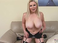 Blonde female from England shakes her jugs on camera and sets flesh-colored dildo in motion 4