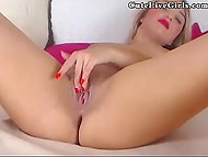 Two fingers inside shaved pussy are enough for Italian chick with bright lipstick to reach orgasm on webcam