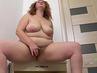 Chubby ginger takes all clothes off and starts to gently examine her hairy pussy
