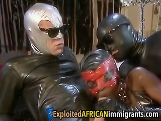 Strange guys in latex costumes have nasty anal threesome with comely Ebony girl